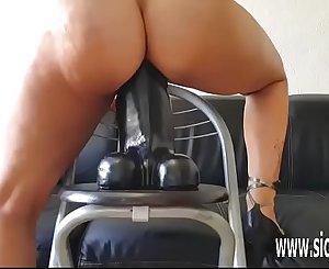 Insatiable amateur slut rides a gigantic fake penis
