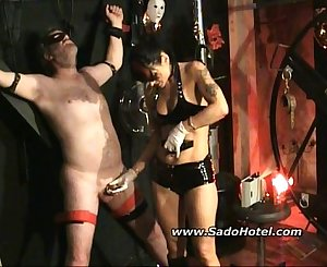 Inserting the slaves dick with iron pin on high voltage